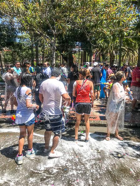 Wet people in Plaza Luis de Fuentes