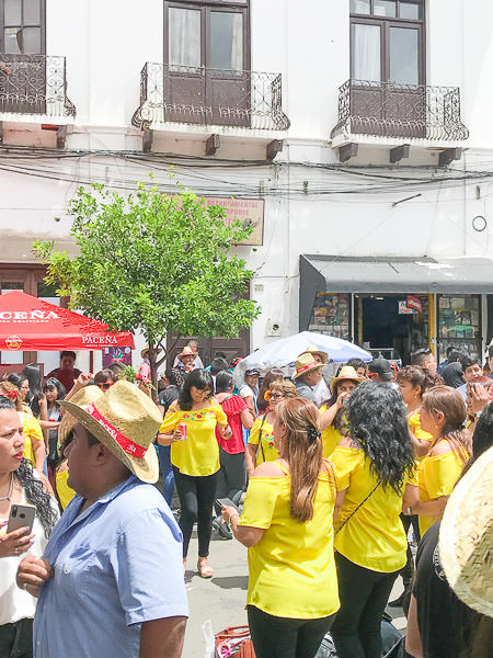 Women dress with the same T-shirt during 'Jueves de Comadres'