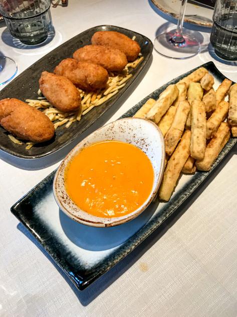 Croquetas de jamón along with palitos de berenjena con salmorejo