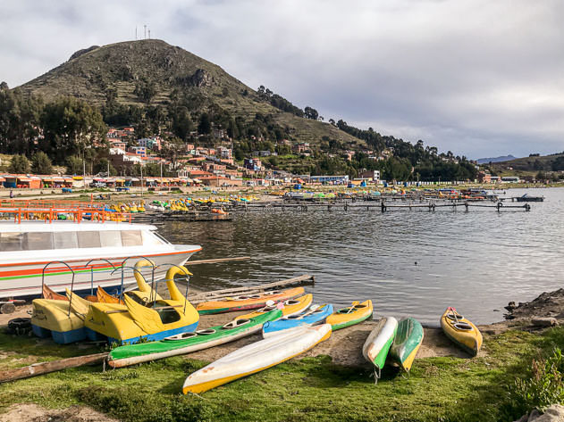 Canoes and pedal boats on the shores of lake Titicaca
